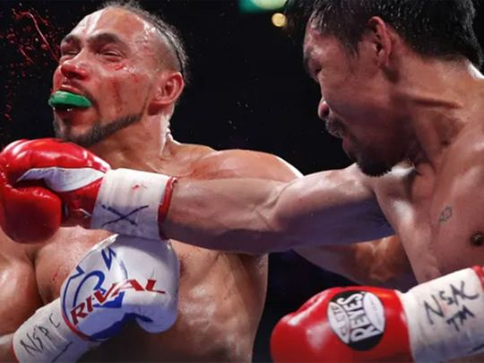 Pacquiao, 40, floored Thurman, 30