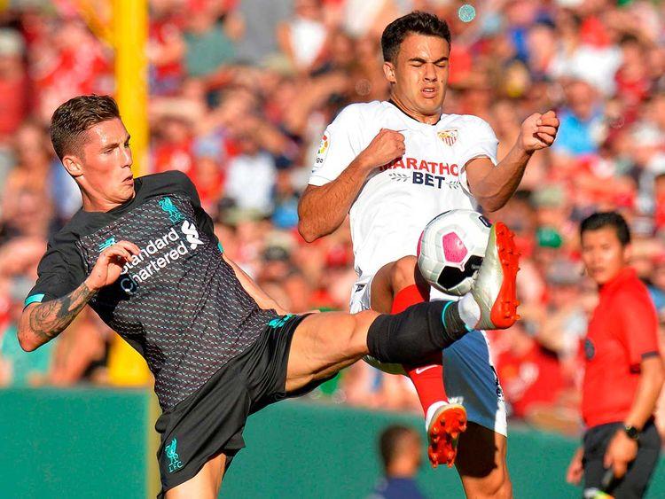 Liverpool's Harry Wilson (L) and Sevilla's Rodriguez Sergio Reguilon