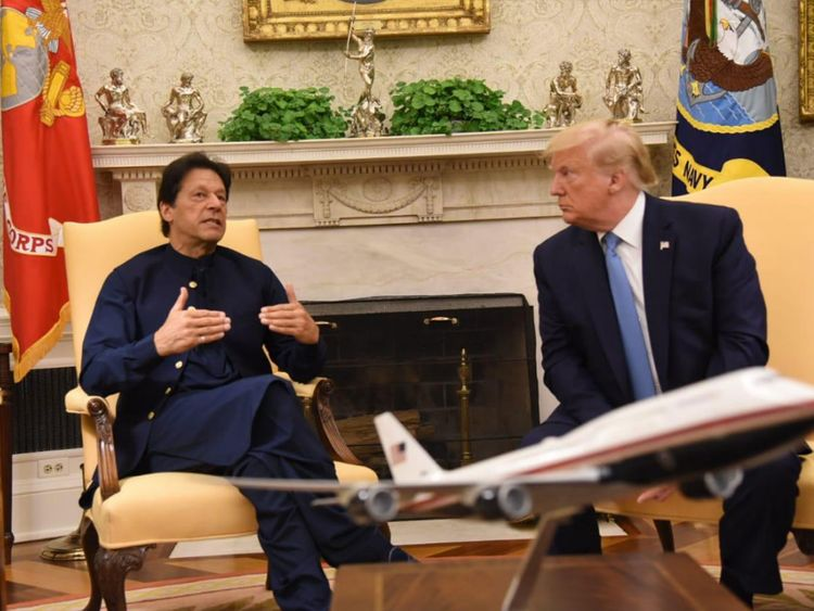 Pakistani Prime Minister Imran Khan speaks alongside