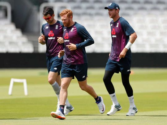 England's Jonny Bairstow with Stuart Broad and James Anderson