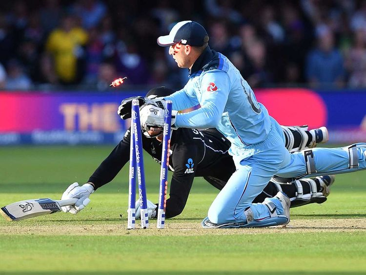 England's Jos Buttler runs out New Zealand's Martin Guptill