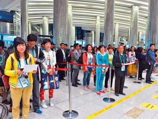 Chinese visitors at Dubai International Airport Terminal 3.
