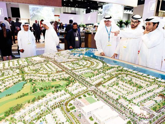 People look at a model of Aldar's Yas Acres Project