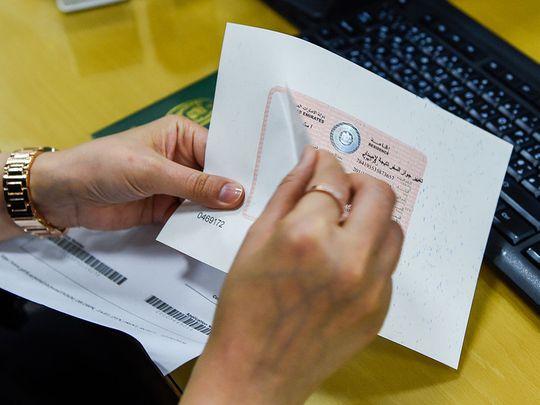 Visa--GDRFA_work permit-1564308210325