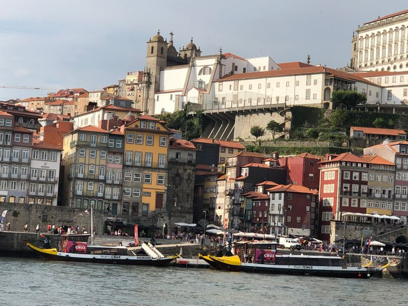 A view of the bustling Ribeira district and its multi-coloured buildings-1564404834412