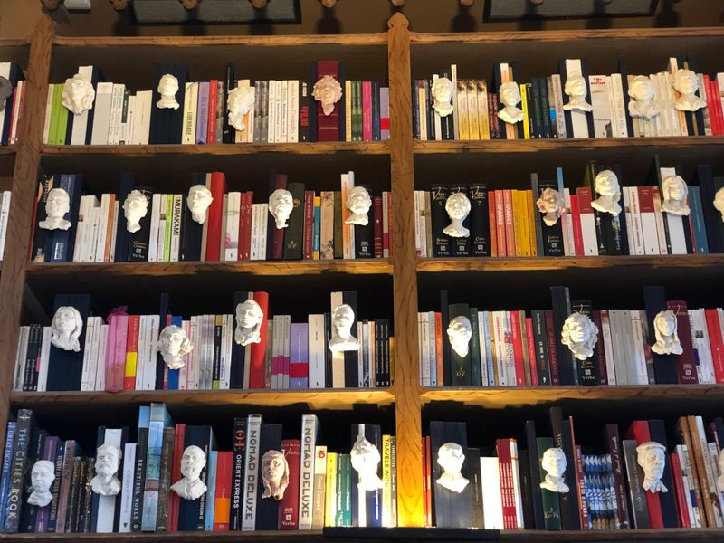 Busts of authors on shelves at Lello Bookshop-1564404845384