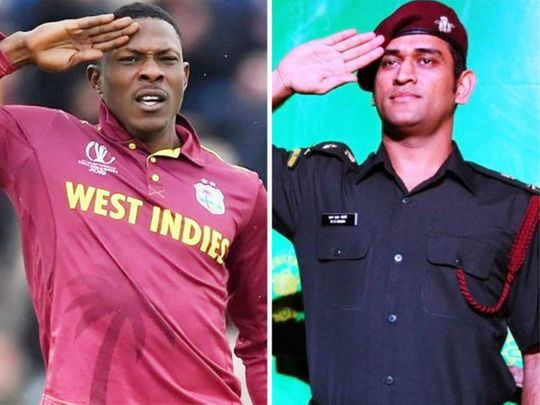 Sheldon Cottrell and MS Dhoni