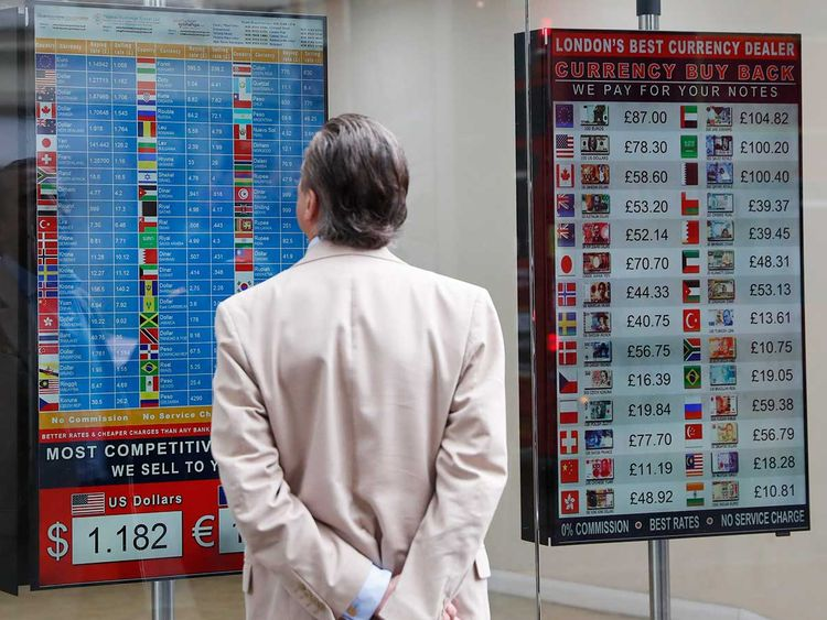 A man looks at a rate list at a currency exchange bureau