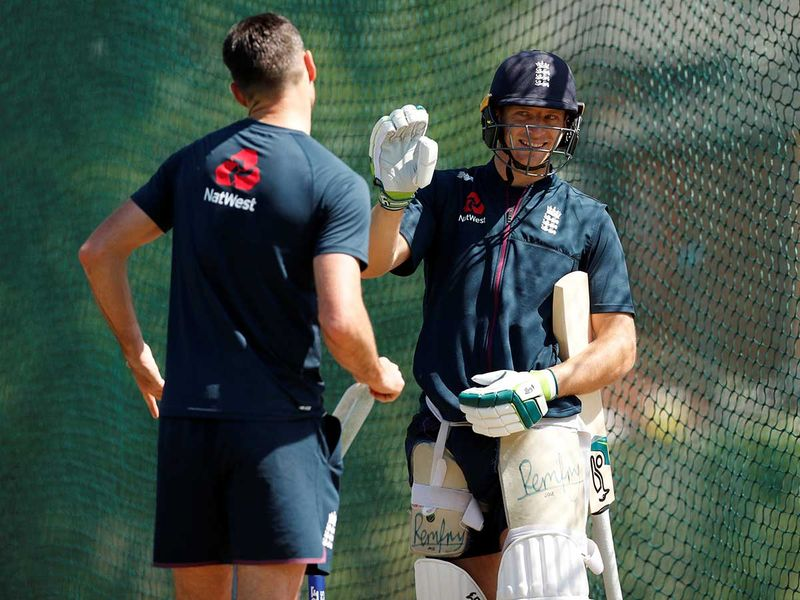 England's Jos Buttler and James Anderson