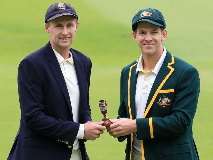 England's captain Joe Root (L) and Australia's captain Tim Paine