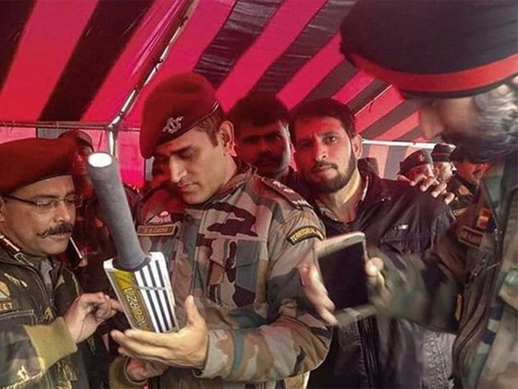 Image of MS Dhoni signing bat in south Kashmir goes viral