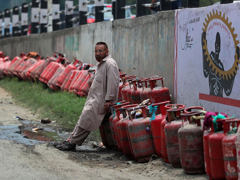 A Kashmiri man waits to buy cooking gas cylinder