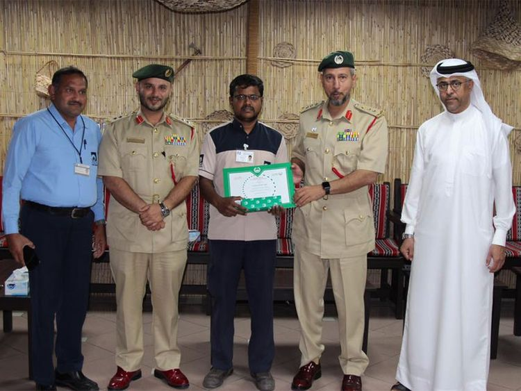 Dubai Police honoured Ali Abdul Raheem, an administrative officer, for returning Dh210,000.