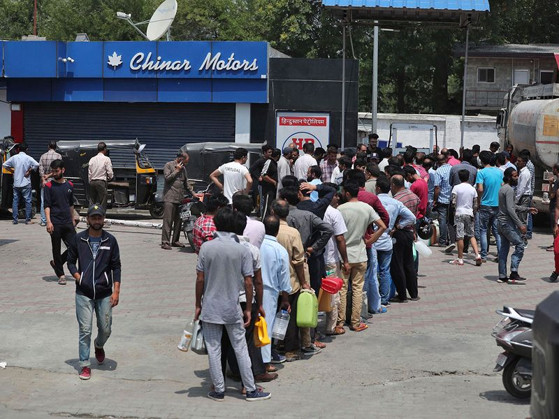 Kashmiri residents queue up at a fuel station in Srinagar,