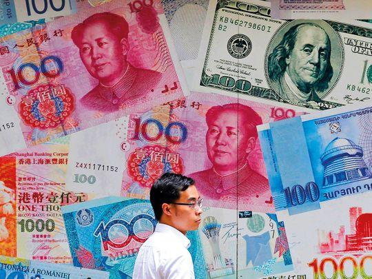 A man walks past a money exchange shop at Central