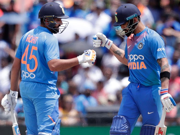 India's Rohit Sharma, left, bumps fist with Virat Kohli
