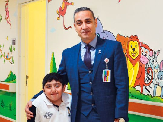 NAT-190805-Dr-Zaid-Aubaidi-with-patient-Mohammad-Hassouneh-(Read-Only)