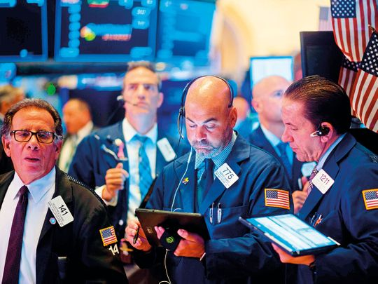Traders work after the opening bell at the New York Stock Exchange