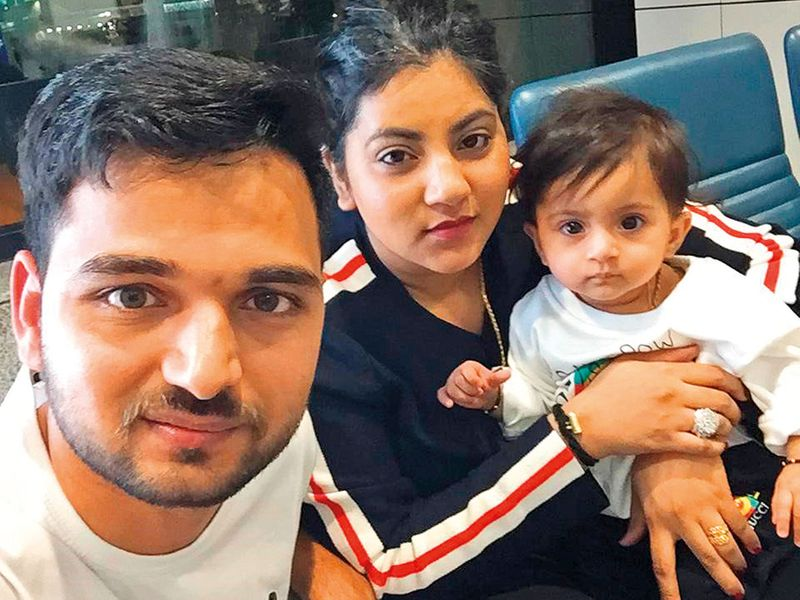 Anurag and Praneeti Sharma with their daughter Jasleen