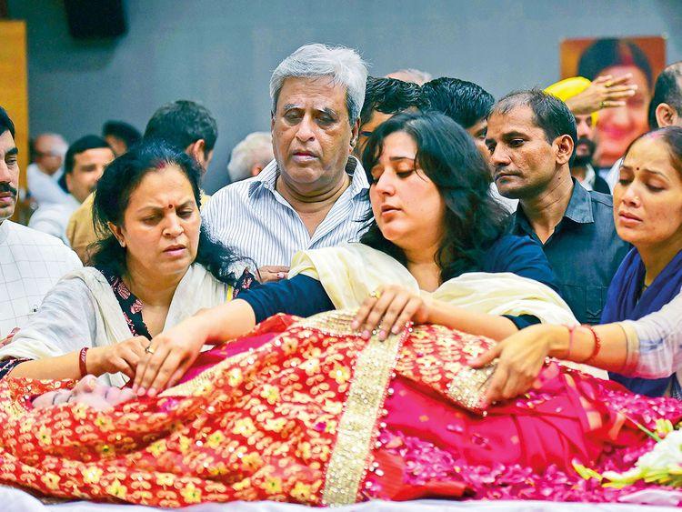 Bansuri Swaraj (centre), daughter, and Swaraj Kaushal (on Bansuri's