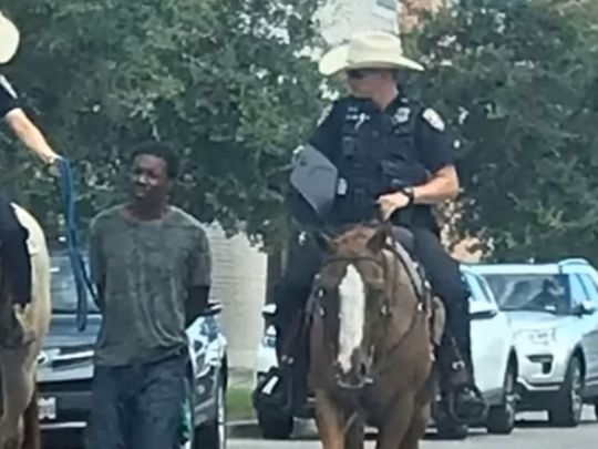 Photo of officers leading black man by a rope in Texas
