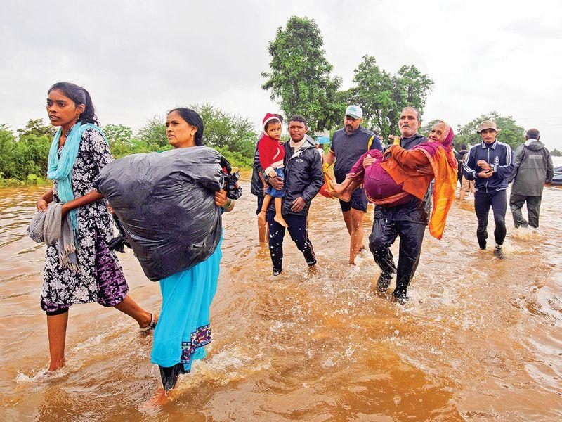 Flood-affected people are evacuated