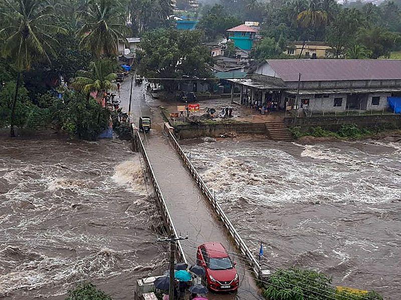 Flood water rushes from under the Kovilkadav Bridge, in Munnar,