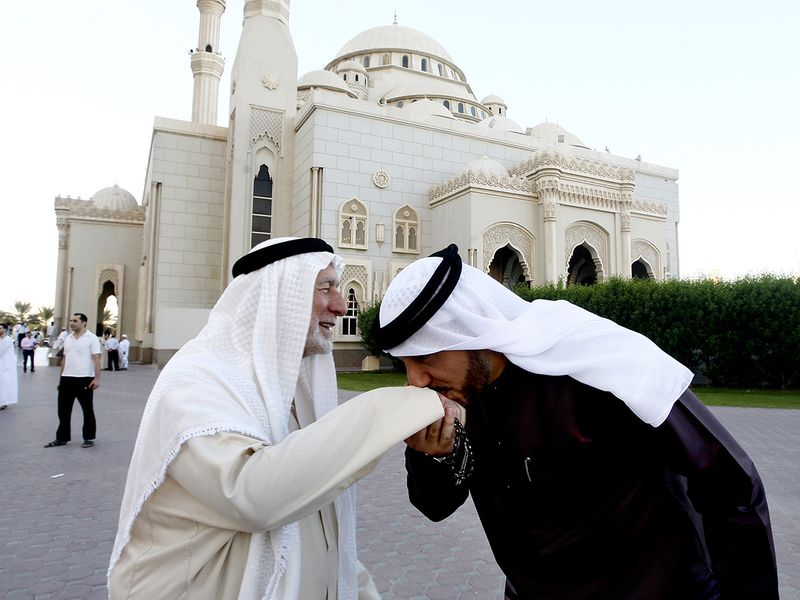 Muslims greeting each other after offering prayers at Al Noor mosque in Sharjah