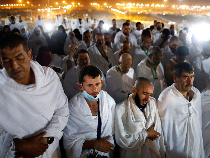 Muslim pilgrims offer dawn prayers Arafat 24515