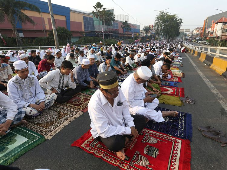 Indonesian Muslims attend Eid Al-Adha prayers Eid