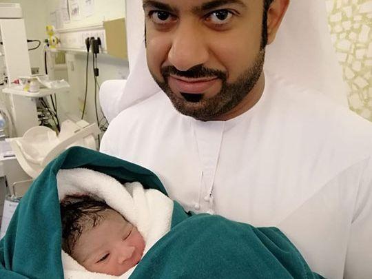 NAT-190811-Mohammed-Salem-Al-Jabri-holding-his-son-born-at-NMC-Hospital-Al-Ain