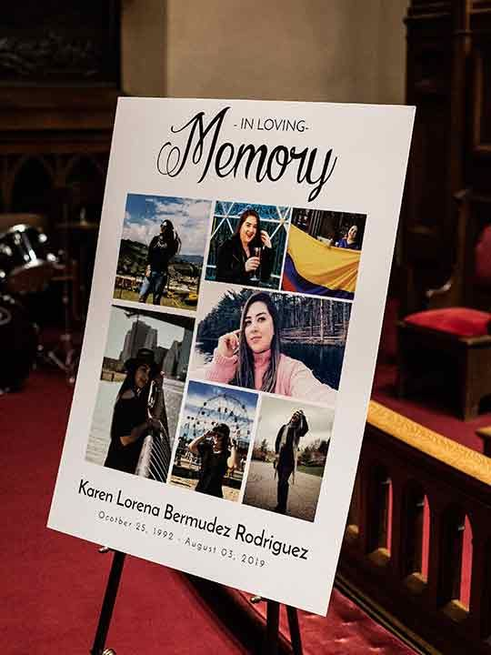 A sign on display at a memorial service for Karen Bermudez-Rodriguez