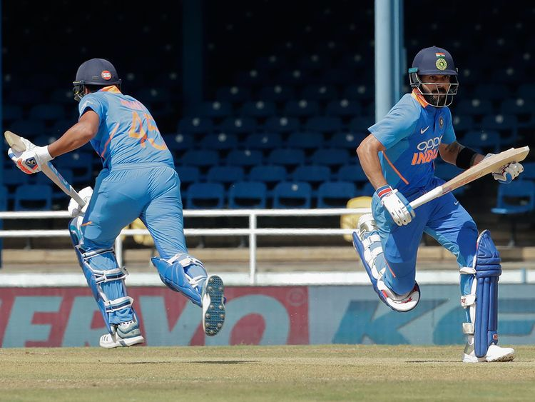 India captain Virat Kohli, right, and Rohit Sharma