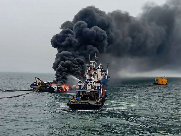 Indian Coast Guard personnel douse the fire