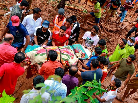 Rescue workers shift a body