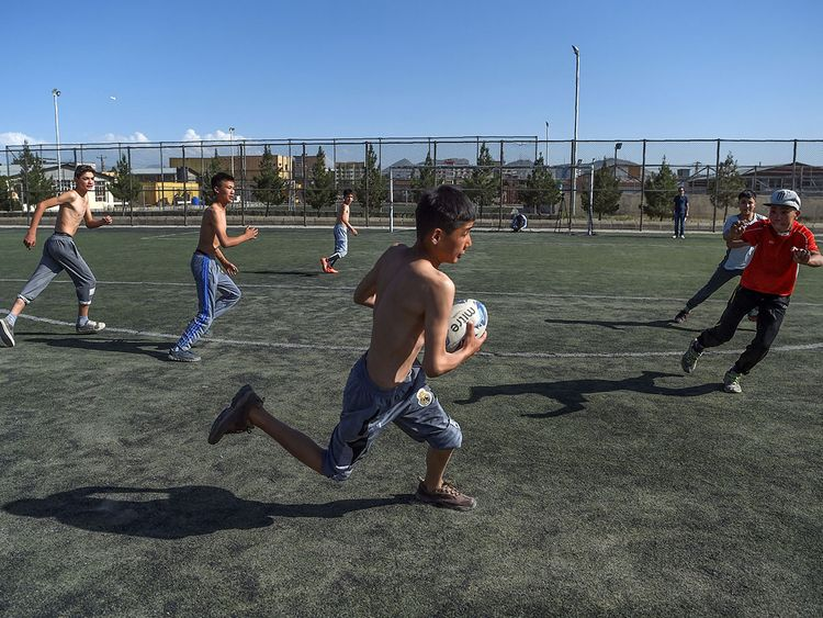 Young rugby players take part in a practice session on a pitch in Kabul.