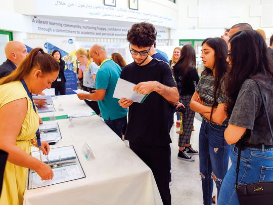 Students check out their A Level results at GEMS Jumeirah College in Dubai