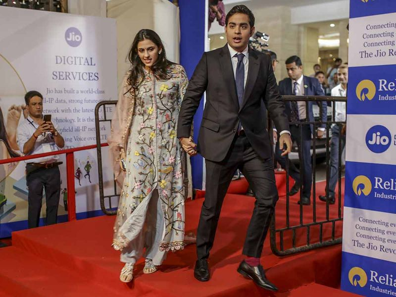 Akash Ambani, right, and his wife Shloka Mehta