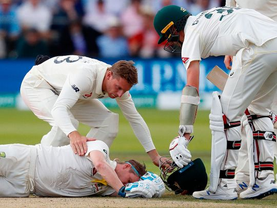 Australia's Steve Smith lays on the pitch