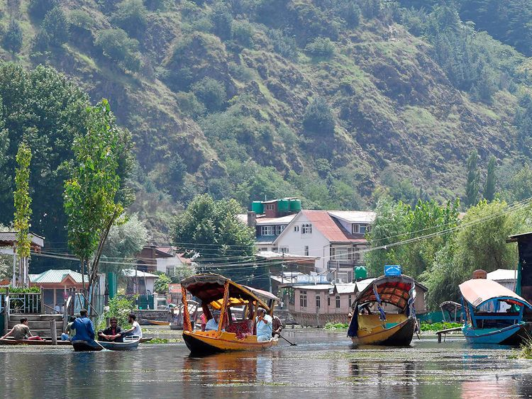 Kashmiri people travel in Shikara boats at Dal Lake in Srinagar