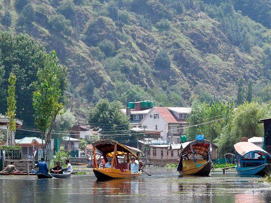 Kashmiri people travel in Shikara boats at Dal Lake in Srinagar