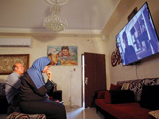 """Reuters Hussein and Suha Abu Khdeir, whose son's murder is the subject of the HBO series """"Our Boys"""", watch the show's first two episodes in their East Jerusalem home August 18, 2019."""