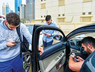 Dubai residents on their smartphones