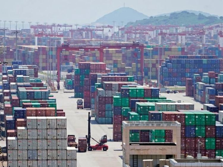 Containers are seen at the Yangshan Deep Water Port in Shanghai, China August 6