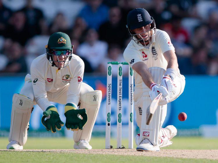 England's Joe Root plays a shot