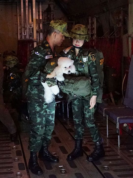 Thailand's King Maha Vajiralongkorn standing with royal noble consort Sineenat Bilaskalayani