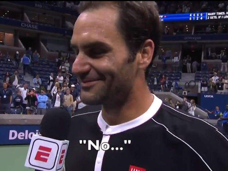 Federer answers a question post match with S. Negal