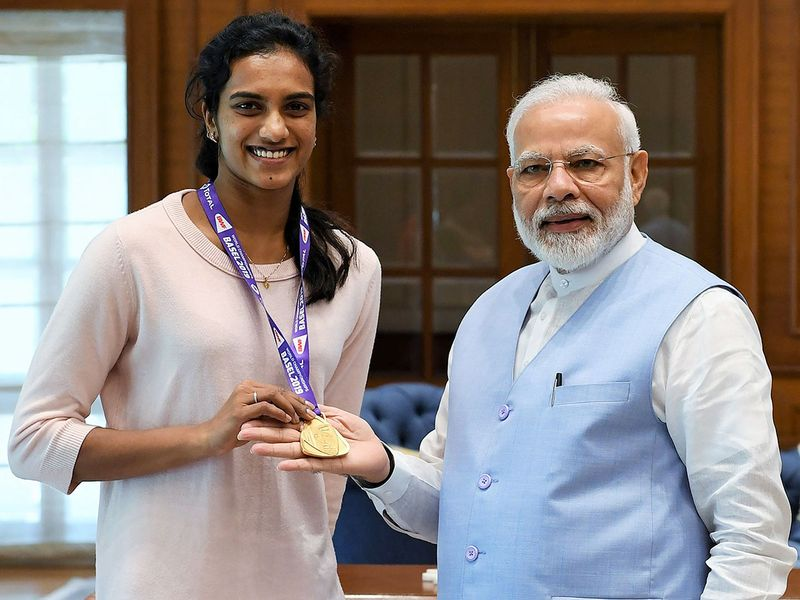 Narendra Modi meets with P.V. Sindhu