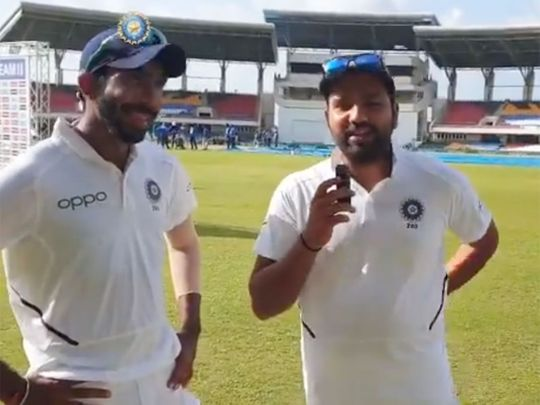 Rohit Sharma (right) interviews Jasprit Bumrah