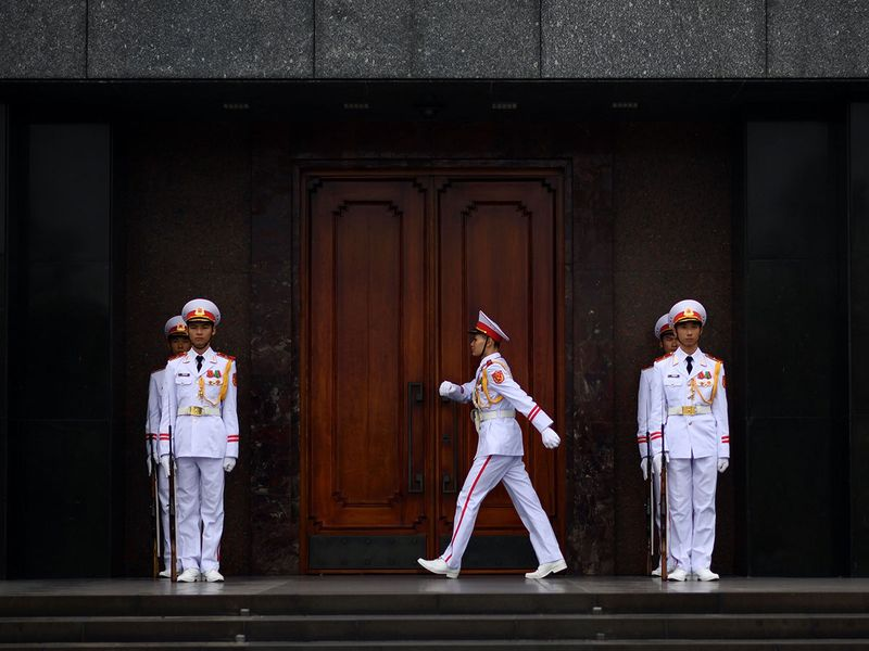 Vietnamese military personnel stationed the outside the Ho Chi Minh mausoleum